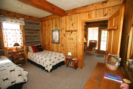 Suite 6 twin bed Riverside Cabin